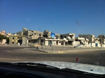 a devastated street in Libya after NATO bombing how did that protect innocent civilians?