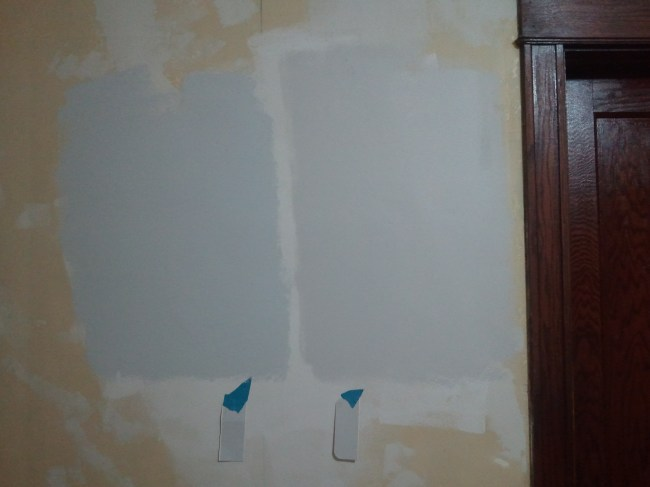 Grey Paint samples for Living Room. Color on the right won.