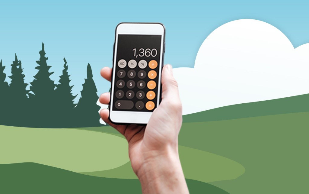 Hands holding calculator in front of illustrated hills