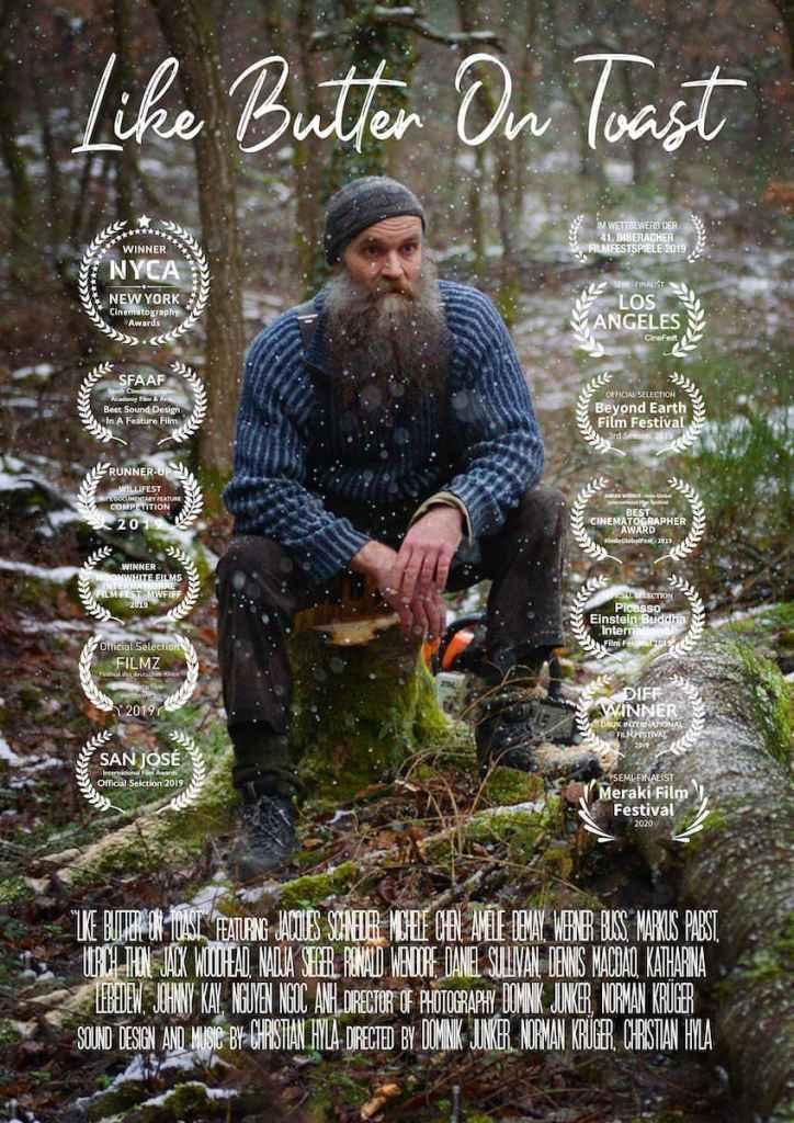 """Poster/Filmplakat zu """"Like Butter on Toast"""" mit dem Bild von Jacques Schneider im Wald, eingerahmt von Festival-Nennungen und gewonnenen Preisen."""