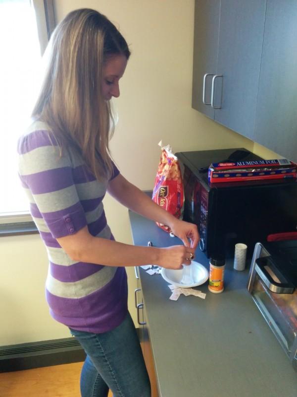 Anna Blazer refills the salt from packets.