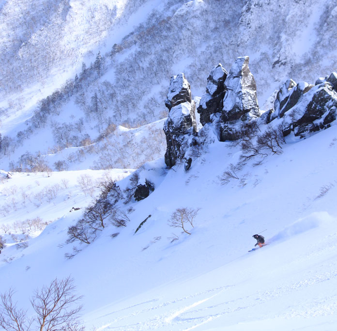 Backcountry skiing above Kurodake