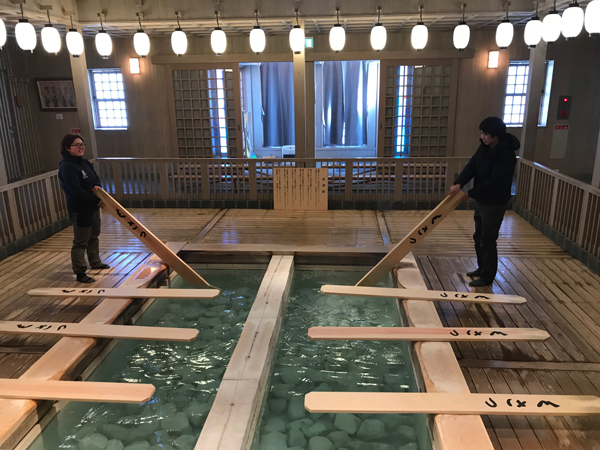 Cooling onsen water with paddles at Kusatsu
