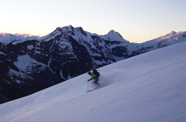 Skiing down Mt Aspiring as the sun drops