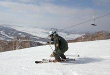 Kamui Ski Links owner Maeda Mitsu skiing groomed runs