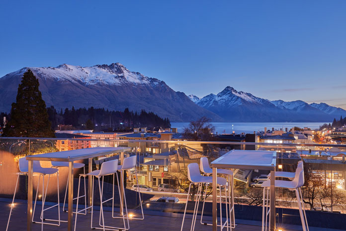 Sunset view over Lake Wakatipu to The Remarkables from mi-pad Queenstown rooftop terrace