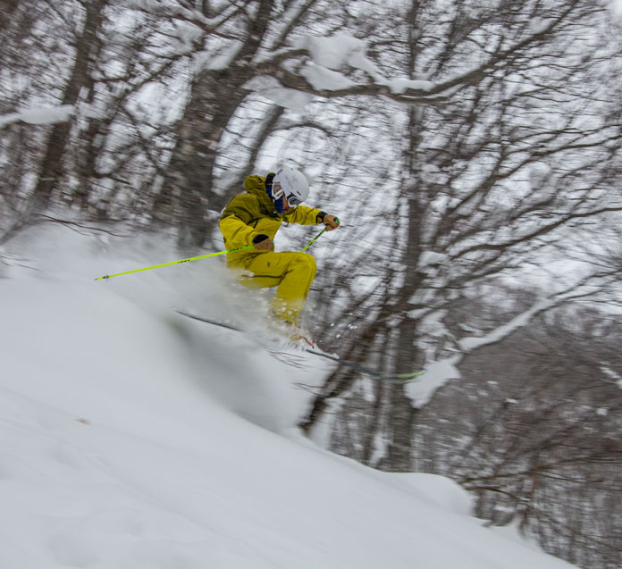 Junya Kurogane pops off a feature in the tree ski zone at Hachimantai Shimokura Ski Resort