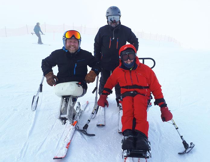 Sit skiers on Disabled Wintersports Australia program at Hotham