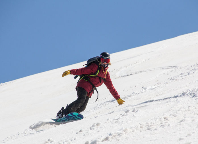 Split boarder Briony Johnson riding Hotham back country in spring snow