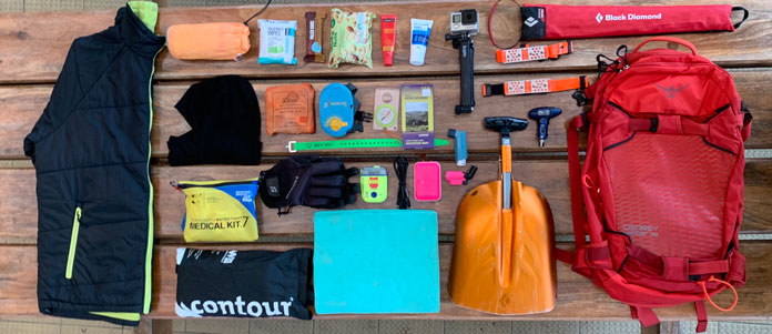 Ultimate ski day pack contents spread out to view