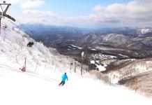 skiing Minowa ski area with a view to Mt Bandai