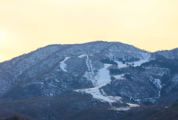 Sunset view looking up at Iox-Arosa ski area, Nanto City, Toyama Prefecture