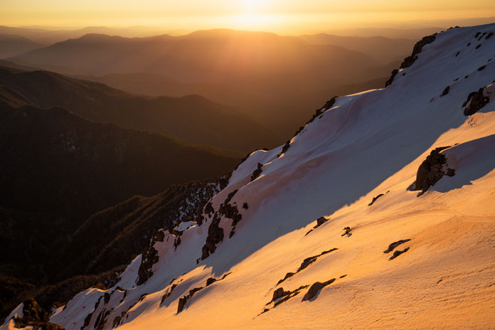 Sunset ski line in Watsons Crags, the steepest runs along the Main Range