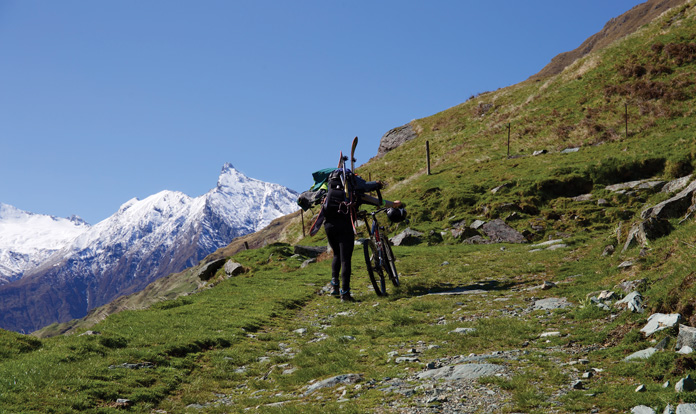 Pushing bikes up the upper Matukituki Valley towards Mt Aspiring