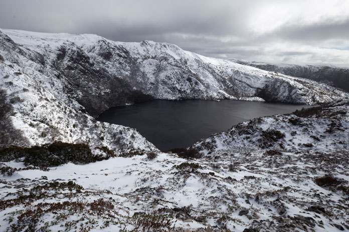 Snow clouds over Crater Lake, Tasmania