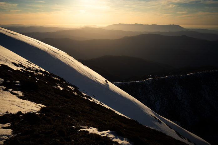 Snowboarder on Mt Feathertop's North Face at dusk