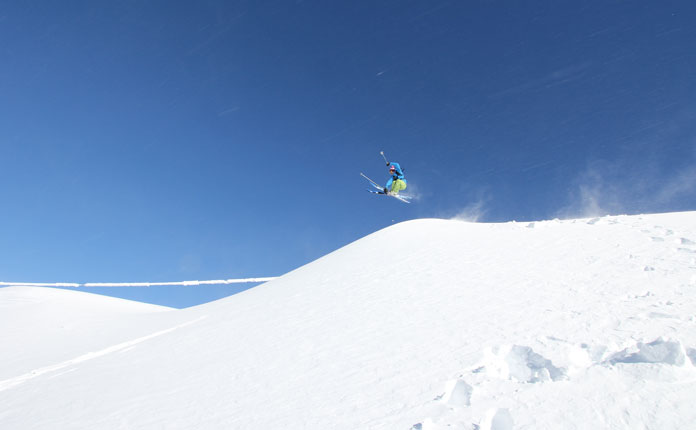 Lone skier on  a powder day on top of Olympic at Perisher