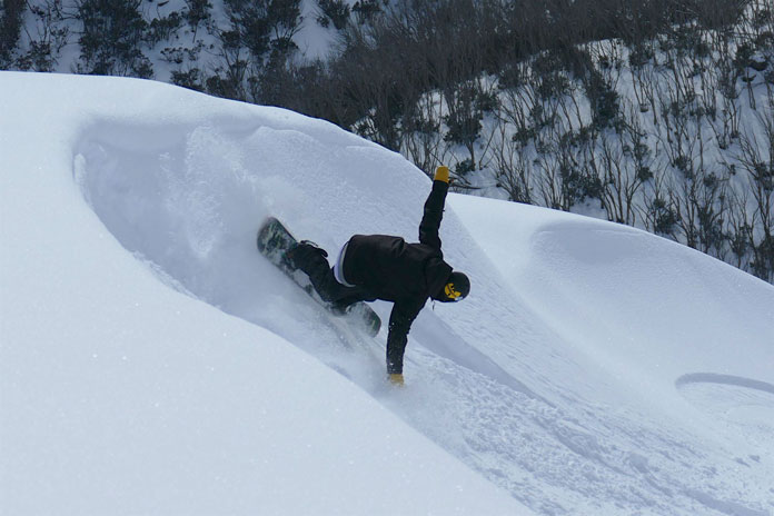 Slashing powder turn on Mt Mckay Backcountry Tours by Steve Lee