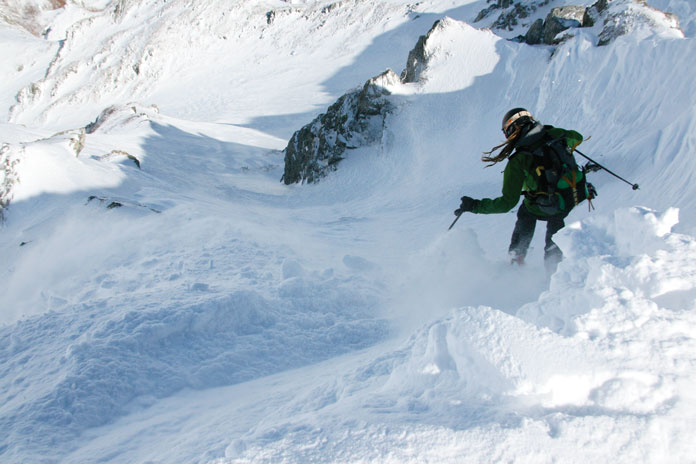Dave Enright drops into the chute for the top of Mt Karamatsu, Hakuba