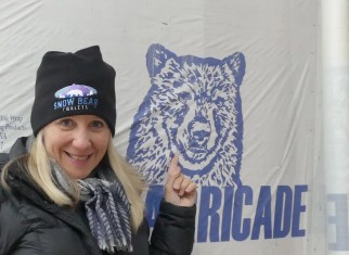 Me, with a snow bear that is actually on the protective wrap on the outside of the chalets