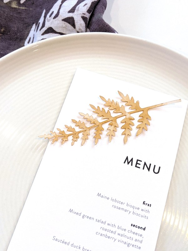 tea stained paper fern leaf on menu