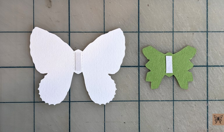 Apply tape to butterfly pieces