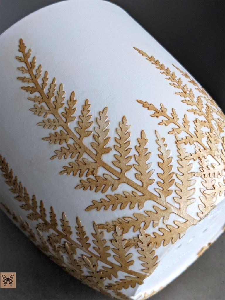 Decoupage tea stained paper fern leaves on plastic flower pot
