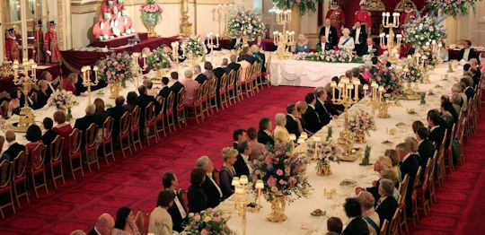 President Obama attends a dinner gathering at Buckingham Palace.