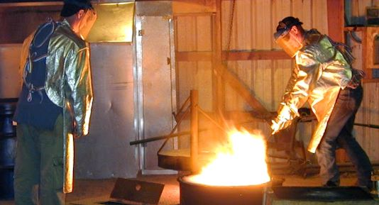The author of this blog (left) and his brother (right) melt brass in preparation for pouring into molds.