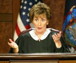 Judge Judy arbitrating over small claims.