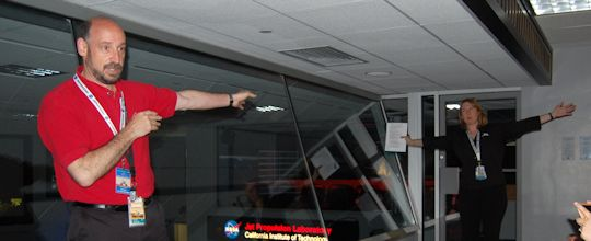 Dr. Randii Wessen and Stephanie Smith demonstrate the finer details of celestial mechanics.