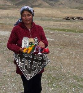 Abdyldaeva Chynar, a Snow Leopard Enterprise craftswoman from Uch Koshkon, shows the fruits of her labor