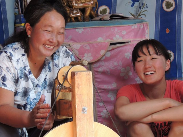 Community members in Tost spinning wool for Snow Leopard Enterprises products - a program supported by Snow Leopard Vodka