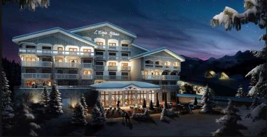 Hotel Ecrin Blanc Courchevel in winter with snow covering the building