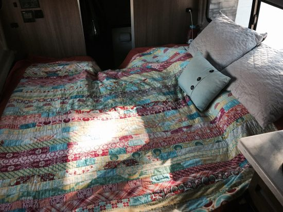 The bed, made up across the van for night. It's slightly smaller than a queen, and only tall enough for someone about 5'8, but it works great for us, is very comfortable, and is simple to set up and take down.