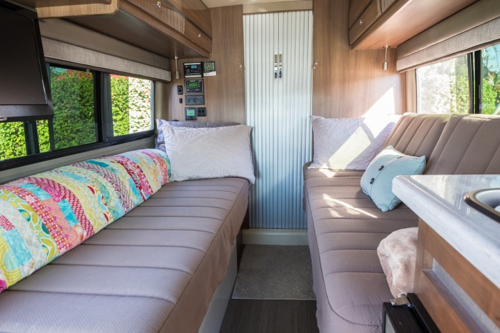 The two twin beds/couches by day become a large bed across the entire van at night. We roll up our bedding to make a back rest for the couch on the left, and the inserts that make the middle of the bed are backrests on the right couch