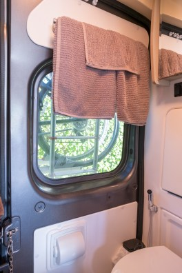 Rear window in the bath - comes with a magnetic curtain that we plan to replace with a roller shade. You can see out this window a little while driving.
