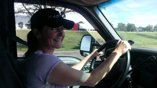 Robin's all smiles behind the wheel of their truck and fifth wheel trailer combo