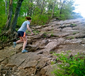 Meghan Turner, 24, of Columbia Mo., tackles some bluffs during an off-trail run. Throwing a new workout or route into your routine is imperative for mental and physical gains.