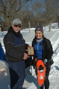 Ottilie Walls proudly displays her Northern Lites Snowshoes that aided her 20 km women's title.