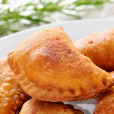 closeup of a plate with some spanish empanadillas, small meat or tuna pies, served as tapas