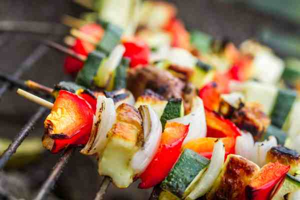 Shish kabobs with meat and vegetables on grill