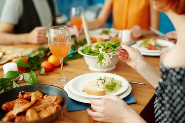 Non Descipt Family Gathered Around a Dinner Table