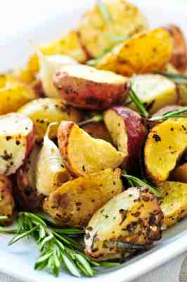 3 ingredient roasted onion potatoes on a white plate