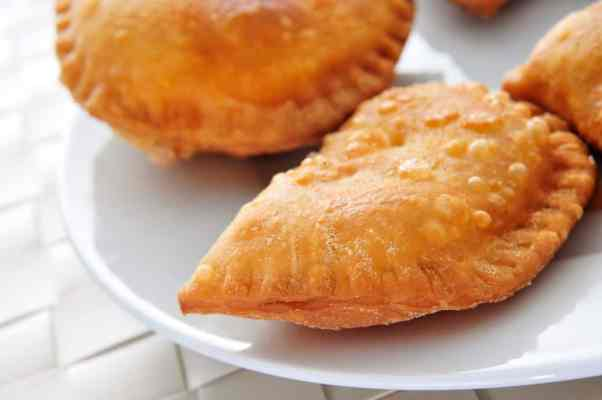 Chicken and potato pastelillos on a white plate