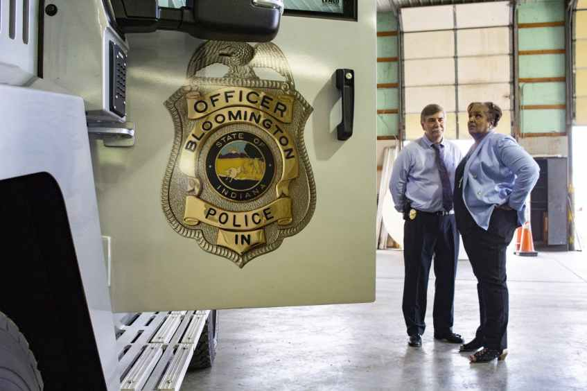 Bloomington Police Department Chief Michael Diekhoff speaks with an attendee at the official unveiling of BPD's new armored vehicle July 10, 2018, in the Switchyard Park Operations building. Monroe County Central Emergency Dispatch personnel will ask all 911 callers screening questions to determine if they may have been exposed to COVID-19 or have symptoms of the virus, according to a BPD press release.