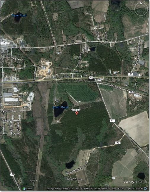 Nothing there in this 3/2013 image.  The long open field to the west is a high-tension power line