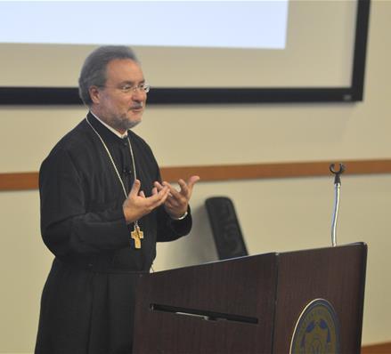 The Rev. John Chryssavgis speaks at Marian University in Indianapolis, Indiana, in December 2014.