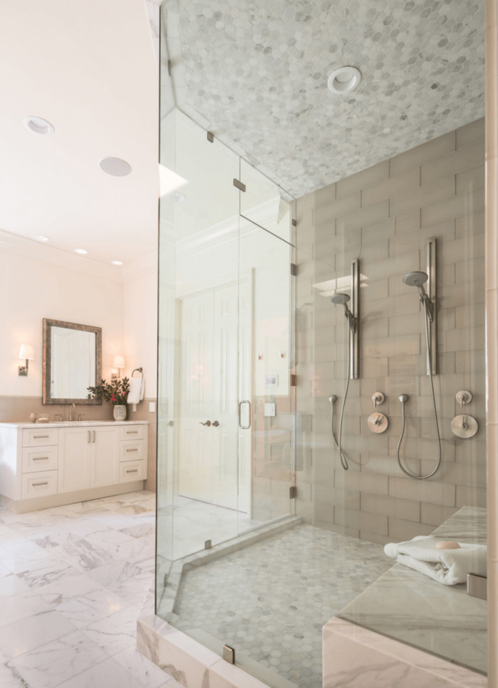 Mix of white and beige tiles in this traditional/transitional master bathroom