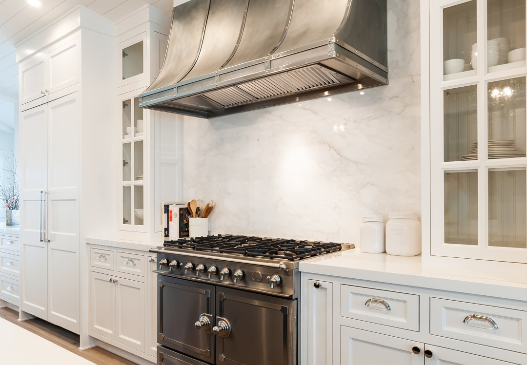 Modern Farmhouse Kitchen - range hood Calcutta countertops